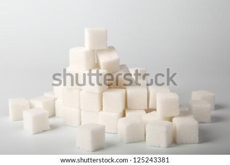 a heap of many white sugar cube - stock photo
