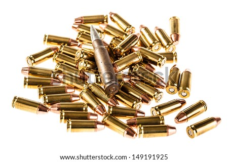 a heap of 9mm pistol bullets isolated over a white background - stock photo