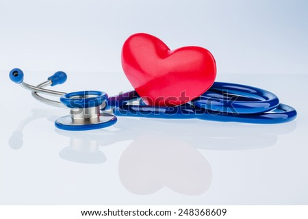 a heart and a stethoscope are adjacent. symbolic photo for heart disease and heartache - stock photo