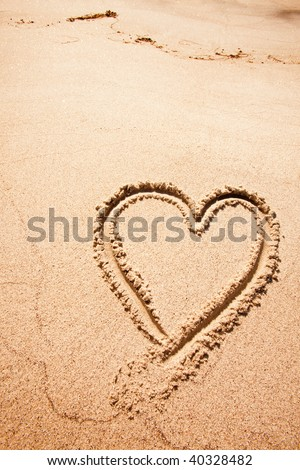 A heart drawn in the sand on a beak