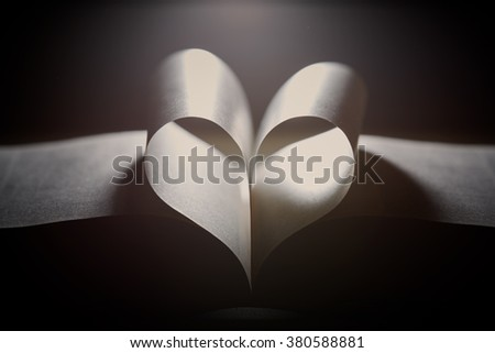 a heart from book's pages - stock photo