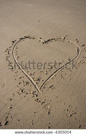 A heart has been drawn on the beach - stock photo