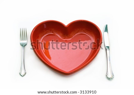 A heart health concept - isolated on white - red heart plate, knife and fork.