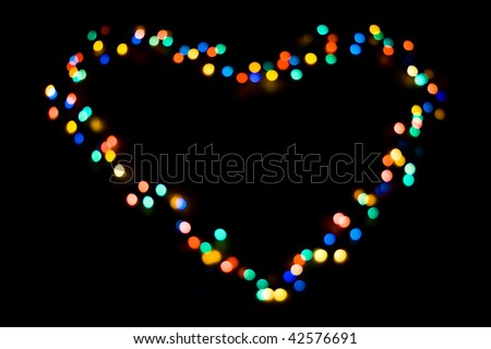 A heart made of colorful lights on black - stock photo