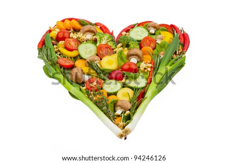 a heart made of vegetables. photo icon on the diet, weight loss and healthy diet. - stock photo