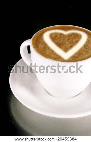 A heart on a creamy cup of cappucinno - stock photo