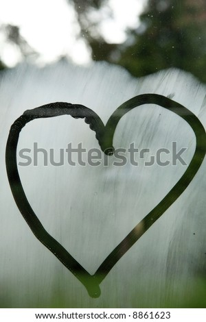 A heart on a steamed up window. - stock photo