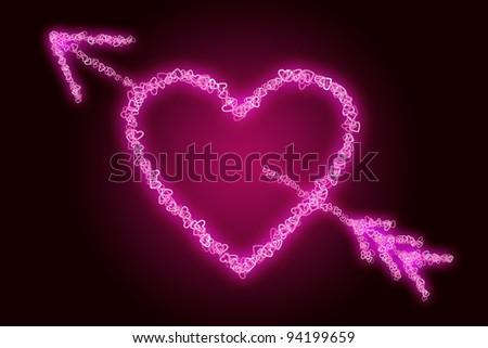 A heart pierced with an arrow. - stock photo