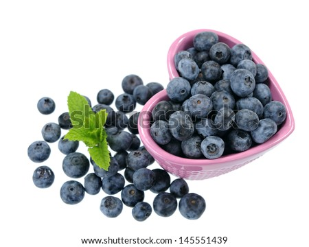 a heart shape bowl of blueberry isolated on white