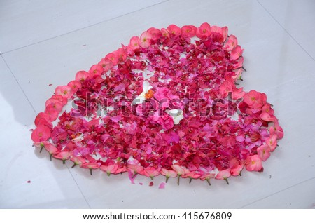 A Heart Shape Created Wirh Red Rose Flower For Welcome Wedding Cople  - stock photo