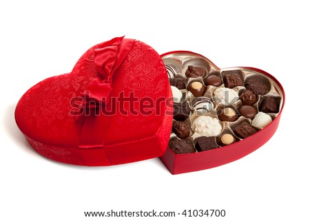 A heart shaped box with Valentine's day candy - stock photo