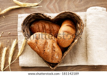 A heart-shaped crate with bread - stock photo