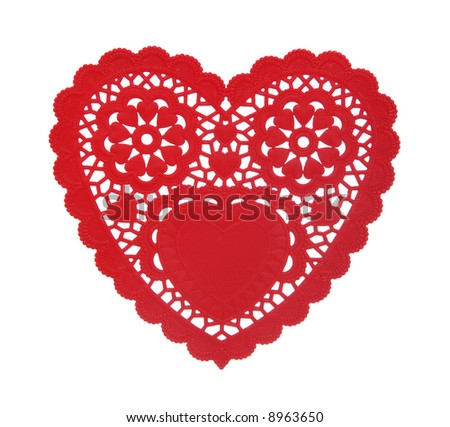 A heart shaped doily isolated over a white background - stock photo