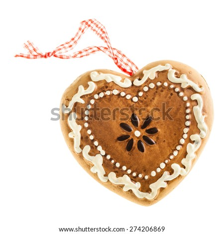 a heart shaped gingerbread christmas ornament isolated over a white background - stock photo