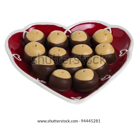 A heart shaped plate of chocolate and peanut butter cookies isolated on white - stock photo