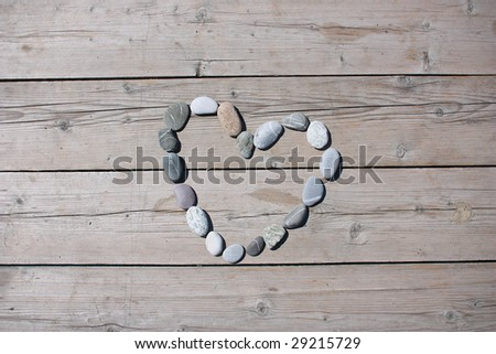 A heart shaped stone on a old wood planks