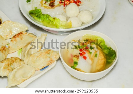 A hearty meal of teowchew fishball noodle for light eater during breakfast or lunch / Fishball noodle / Made exclusively of fish paste and moulded into balls or fishcake slices, healthy eating - stock photo