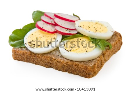 A hearty whole wheat sandwich with lettuce, radishes and eggs