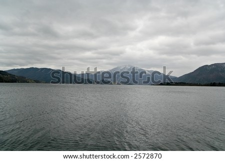A heavily cloudy weather over a lake