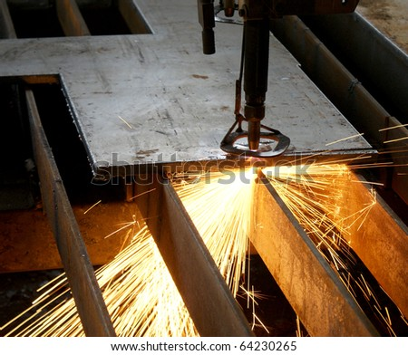 A heavy machine that cuts metal sheets into smaller peaces. - stock photo