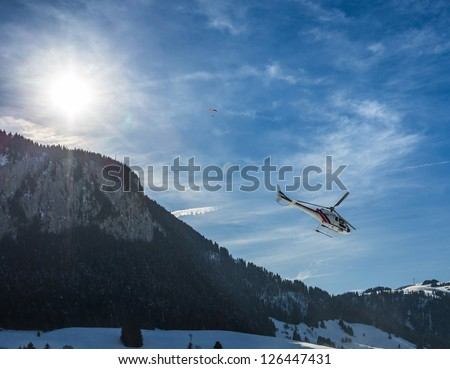 A helicopter flying in Swiss Alps.