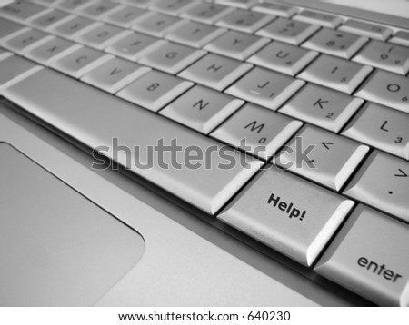 A Help! key next to the space bar in focus with all the surrounding keys out of focus - stock photo