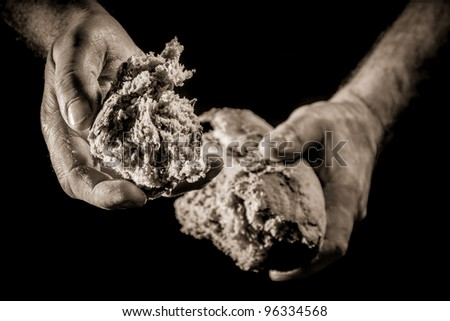 A helping hand with piece of bread - stock photo