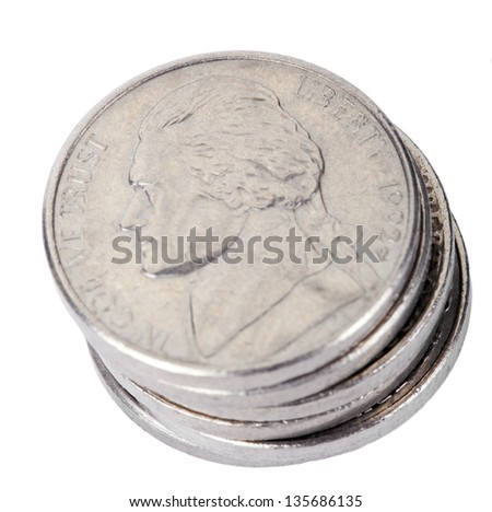 A high angle shot of a stack of 5 US cents (Nickel) coins isolated on white background. The obverse side of the coin is seen here, depicting Thomas Jefferson's profile portrait. - stock photo