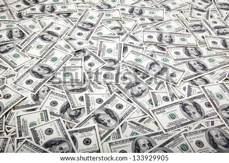 A high angle view of a very large amount of 100 US$ money notes in a bulky mess. - stock photo
