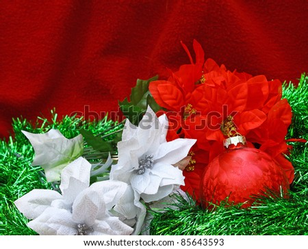 A high contrast Christmas ball and poinsettia blooms with room for your text - stock photo