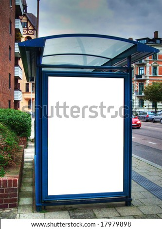 A high dynamic range image of a bus stop with a blank billboard for your advertising