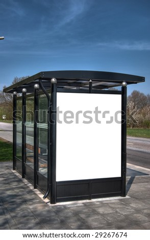 A high dynamic range image of a bus stop with a blank billboard for your advertising - stock photo