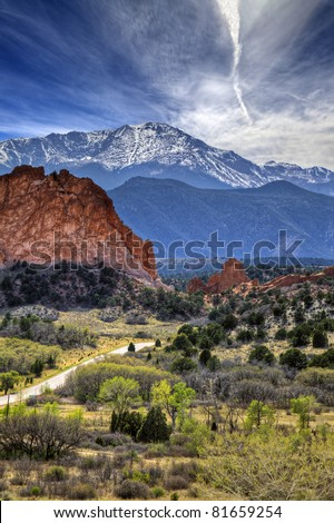 A High Dynamic Range photo of the Garden of the Gods park in Colorado Springs, Colorado with Pikes peak in the background. - stock photo