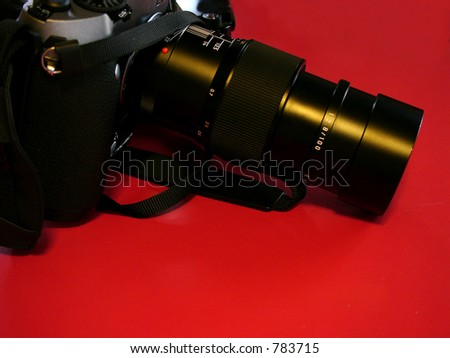 A high end film camera and zoom lens made for professional's use. - stock photo