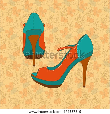 a high-heeled vintage orange shoes on hand draw floral pattern - stock photo