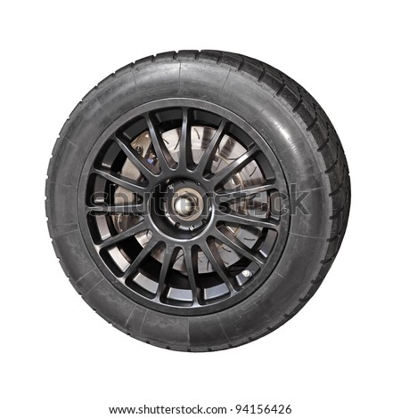 A high performance racing tire mounted on a matt wheel rim, isolated against white. - stock photo