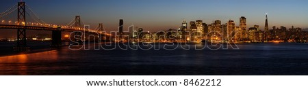 A high-resolution stitched image of Bay Bridge and San Francisco downtown in Christmas lighting (shot from Treasure Island).  Copyspace on top and bottom. - stock photo