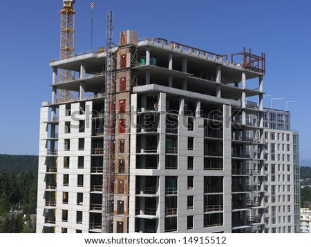 A high rise condo being constructed in downtown Bellevue (a suburb of Seattle), Washington. - stock photo