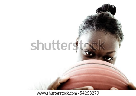 A high school basketball player, shot in the studio. - stock photo