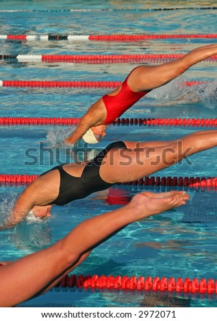 A high school swim meet and the athletes who compete for their school - stock photo