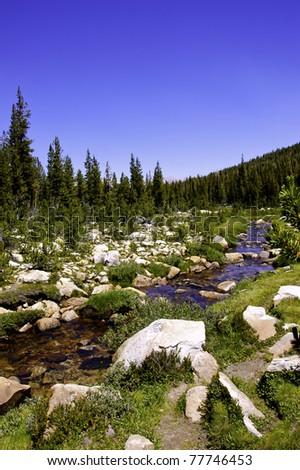 A high sierra stream flowing thru a rocky meadow - stock photo