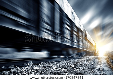 A high-speed Freight train, motion blur. - stock photo