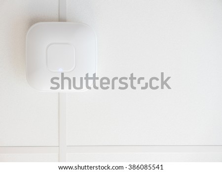 A High Speed Wifi Access Point On A Ceiling With Copy Space - stock photo