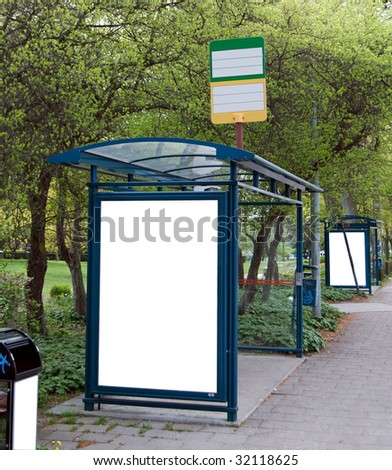 A high street view of some bus stops with blank billboards for your advertising