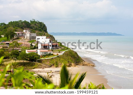A high view looking down at the beautiful vista of turquoise water and sandy beach near Jama Ecuador - stock photo