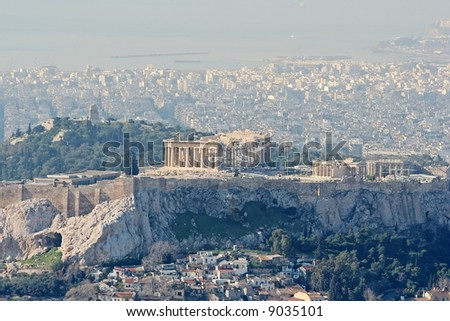 A high view of the Acropolis of Athens, Greece, the Plaka area, and the Filipappoy hill, in the morning light - stock photo
