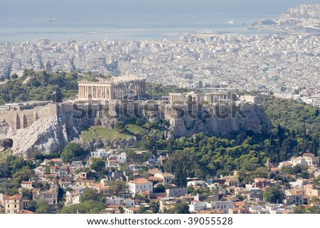 A high view of the Acropolis of Athens, Greece, the Plaka area, the Filipappoy hill, and the Saronic gulf waterfront - stock photo