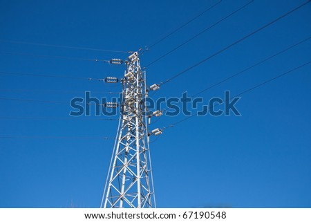 A high voltage powerline - stock photo