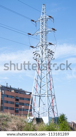 a high voltage tower in a city