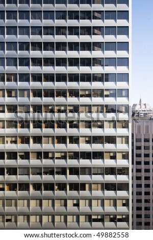 A highly repetitive downtown office building facade represents the nature of modern life - stock photo